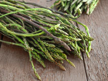 Wild asparagus on wooden background Royalty Free Stock Image