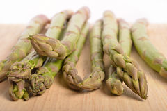 Wild asparagus on wooden board Royalty Free Stock Photos