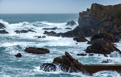 Wild Atlantic storm waves breaking on rocky coast. Wild Atlantic waves on Portugal's coast at cabo Sardao Stock Images