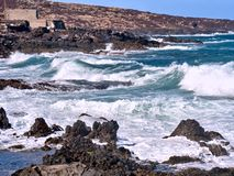 Wild atlantic with waves and spray on a funeral spring day. With fierce wind in Puertito de Guimar on Tenerife, Canarian Island royalty free stock images
