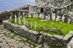 Wild Atlantic Way: High above the wild Atlantic Ocean, Ancient Irish Christian Monks` Graveyard. The 22 crosses in the Monks` Graveyard are believed to be in stock image