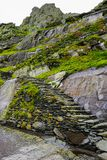 Wild Atlantic Way Ireland: One vulnerable step at a time: Ascending unprotected ancient rocky steps to Skellig Michael Monaster. royalty free stock image