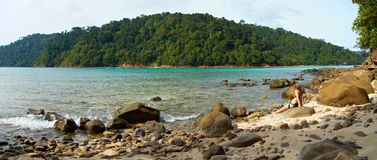 On a Wild Beach. A wild stony tropical beach on Sapi island near Borneo, Malaysia Royalty Free Stock Photography