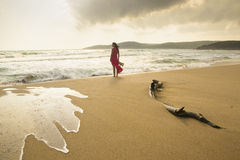 Wild beach. Young woman on a wild beach enjoying the natural beauty Royalty Free Stock Photos