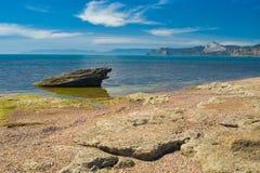 Wild beach on a Black Sea shore on Meganom cape Royalty Free Stock Photography