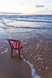 Wild beach with chair Stock Images