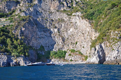 Wild beach in the cliffs of the Amalfi coast. And bright blue sea Royalty Free Stock Images