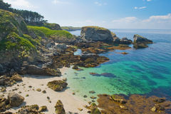 Wild beach in the island Belle Ile en Mer. The image of a wild beach with emerald water in the coast of island Belle Ile en Mer. France Stock Image
