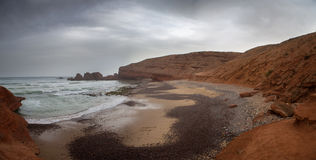 Wild beach on Legzira coast with cliffs in the south of Morocco Royalty Free Stock Photography