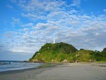 Wild beach and lighthouse at Ilha do Mel (Honey Island) near Cur Royalty Free Stock Photos
