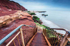 Wild beach and red rock cliffs in site Jurassic Coast in UK Stock Image