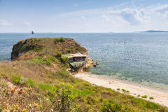 Wild beach with small abandoned restaurant Royalty Free Stock Photography