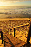 Wild beach sunset and stairway Stock Images