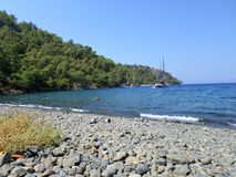 Wild beach in Turkey. Secluded Boncuklu beach in Fethiye, Turkey Royalty Free Stock Images