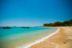 Wild beach in Vietnam. Boats on the sea and wild beach in Vietnam Royalty Free Stock Image