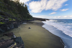 Wild beach with volcanic rocks at Reunion Island Royalty Free Stock Image