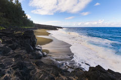 Wild beach with volcanic rocks at Reunion Island Stock Photography
