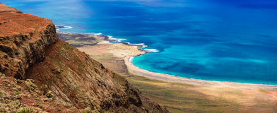 Wild beautiful beaches of volcanic island Lanzarote, Canary isla Royalty Free Stock Photography