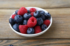 Wild berries on a plate Royalty Free Stock Photo