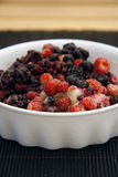 Wild Berries served in a bowl Stock Photo