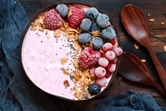 Wild berries smoothie bowls. Topped with frozen berries and granola Royalty Free Stock Image
