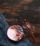 Wild berries smoothie bowls. Topped with frozen berries and granola Stock Images
