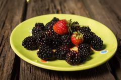 Wild berries and strawberry Royalty Free Stock Photo