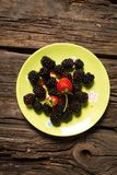 Wild berries and strawberry Royalty Free Stock Photos