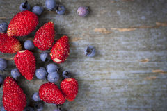 Wild berries on wood background Stock Photos