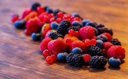 Wild berry mix - strawberries, raspberries, blackberries, blueberries and currants. A Wild berry mix - strawberries, raspberries, blackberries, blueberries and Royalty Free Stock Image
