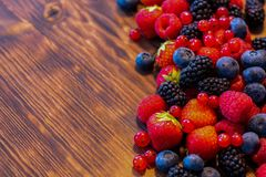 Wild berry mix - strawberries, raspberries, blackberries, blueberries and currants. A Wild berry mix - strawberries, raspberries, blackberries, blueberries and Royalty Free Stock Images