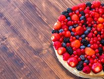 Wild berry mix with strawberries, raspberries, blackberries, blueberries and redcurrants on a fruit cake. A Wild berry mix - strawberries, raspberries Stock Photo