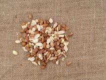 Wild bird food - unsalted peanuts, on hessian. Help feed garden birds wildlife in winter. Overhead view. Wild bird food - unsalted peanuts, on hessian. Help royalty free stock image