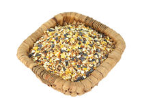 Wild bird food in wicker basket Stock Photos