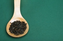 Wild black rice in wooden spoon Royalty Free Stock Image