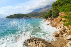 Wild blue sea and cloudy sky Stock Images