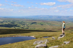 Wild Boar Fell to Sand Tarn and the Eden Valley. Looking North West from the North Western slopes of Wild Boar Fell in Cumbria, England past Sand Tarn towards Royalty Free Stock Image