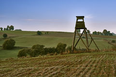 Wild boar hunting tower, in field Royalty Free Stock Photo