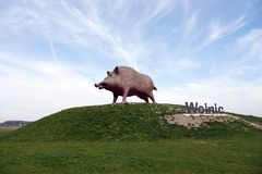 Wild boar statue symbol of the French Ardennes region. Woinic, the largest boar in the world, is a giant steel beast that stands as both a roadside curiosity stock photography
