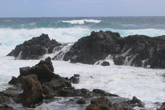 Wild breaking waves on the east coast of Lanzarote. Royalty Free Stock Images