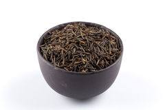Wild brown rice in bowl Royalty Free Stock Image