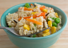Wild and brown rice with veggies in bowl with fork Royalty Free Stock Photo