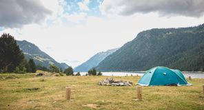 Wild camping atmosphere on a lake in the middle of the Pyrenees in France. With a tent, a gas rechaud stock image
