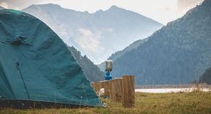 Wild camping atmosphere on a lake in the middle of the Pyrenees in France. With a tent, a gas rechaud stock photo