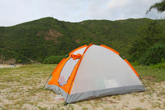 Wild camping on beach with tent Stock Photo