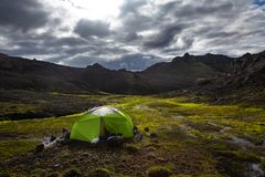 Wild camping in a bright lime green tent in icelandic mountains Stock Image
