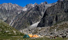 Wild camping. In Caucasian mountains. Tents. Caucasian wild goats. Russia Royalty Free Stock Image