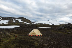 Wild camping in Iceland lava field with white cap. Wild camping in Iceland lava field with white cap of Snaefellsjokull volcano summit on the horizon. Hiking in Stock Photography