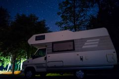 Wild camping with motorhome. Camping with motorhome in mountains. Night scenery Stock Photography