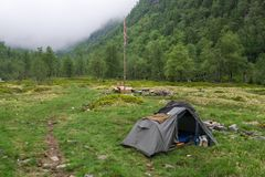 Wild camping in Norway. Wild camping at meadow in Norway mountains Stock Photo